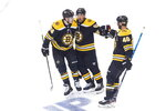 Boston Bruins' David Krejci (46) celebrates his goal against the Carolina Hurricanes with teammates Jake DeBrusk (74) and Brad Marchand (63) during the first period of an NHL Eastern Conference Stanley Cup hockey playoff game in Toronto, Thursday, Aug. 13, 2020. (Chris Young/The Canadian Press via AP)