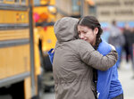 Gabriela Mauricio, right, a 14-year-old freshman, hugs her mother Meche Mauricio, after the two were reunited outside Waukesha South High School in Waukesha on Monday, Dec. 2, 2019. Gunshots were exchanged between a student and a school resource officer inside Waukesha South High School, according to school officials. (Mike De Sisti/Milwaukee Journal-Sentinel via AP)