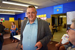 FILE - In this Friday, June 8, 2018, file photo, Democratic U.S. Sen. Jon Tester speaks with a supporter during an event at the Tester campaign headquarters in Billings, Mont. Political observers say a key factor in deciding the outcome of Montana's high-profile Senate race will be whether independent women who voted for Donald Trump in 2016 stick with the president and Republican Senate candidate Matt Rosendale this year. Democratic leaders and advocacy groups say women are highly motivated to vote in the Nov. 6 election with absentee ballots being mailed out on Friday, Oct. 12, 2018. (AP Photo/Matthew Brown, File)