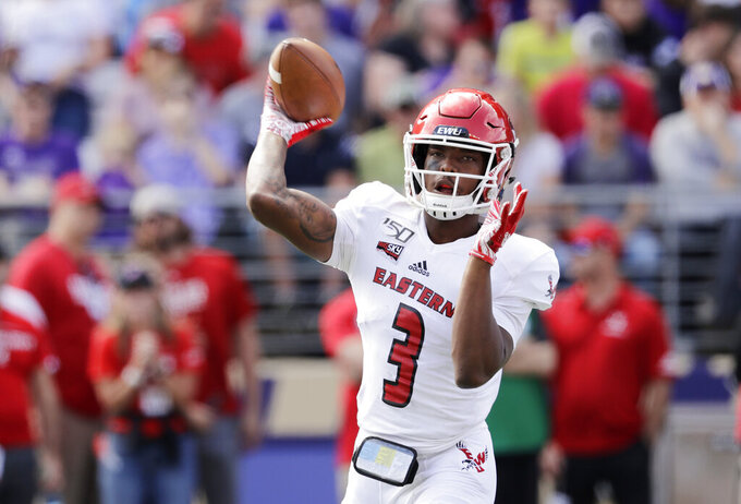 Eastern Washington quarterback Eric Barriere passes against Washington in the first half of an NCAA college football game Saturday, Aug. 31, 2019, in Seattle. (AP Photo/Elaine Thompson)