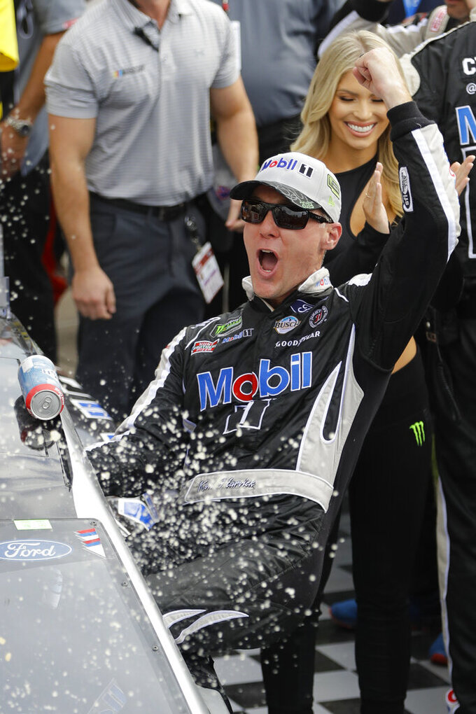 Kevin Harvick celebrates after winning the NASCAR Brickyard 400 auto race at Indianapolis Motor Speedway, Sunday, Sept. 8, 2019, in Indianapolis. (AP Photo/Darron Cummings)