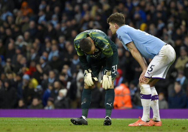 Manchester City's goalkeeper Ederson, left, and Manchester City's John Stones react after Manchester City's Fernandinho scores an own goal during the English Premier League soccer match between Manchester City and Crystal Palace at Etihad stadium in Manchester, England, Saturday, Jan. 18, 2020. (AP Photo/Rui Vieira)