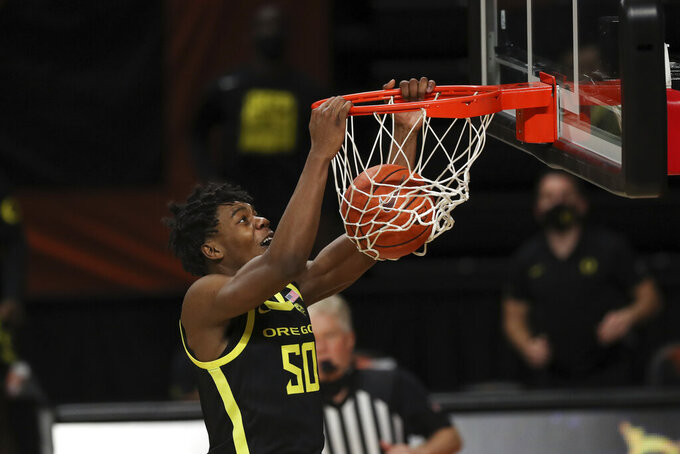 Oregon's Eric Williams Jr. (50) dunks against Oregon State during the second half of an NCAA college basketball game in Corvallis, Ore., Sunday, March 7, 2021. (AP Photo/Amanda Loman)