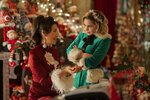 This image released by Universal Pictures shows Michelle Yeoh, left, and Emilia Clarke in a scene from