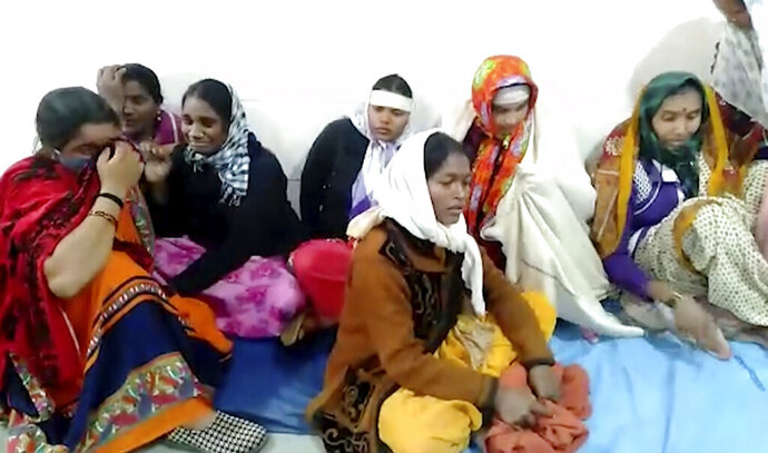 This frame grab from video provided by KK Productions shows women grieving at District General Hospital where a fire broke out in Bhandara, about 70 kilometres from Nagpur, India, Saturday, Jan. 9, 2021. A fire broke out in the intensive care unit of a government-run hospital in western India early Saturday, killing 10 infants, police and news reports said. Firefighters rescued seven babies from the newborn care unit of the hospital. (KK Productions via AP)