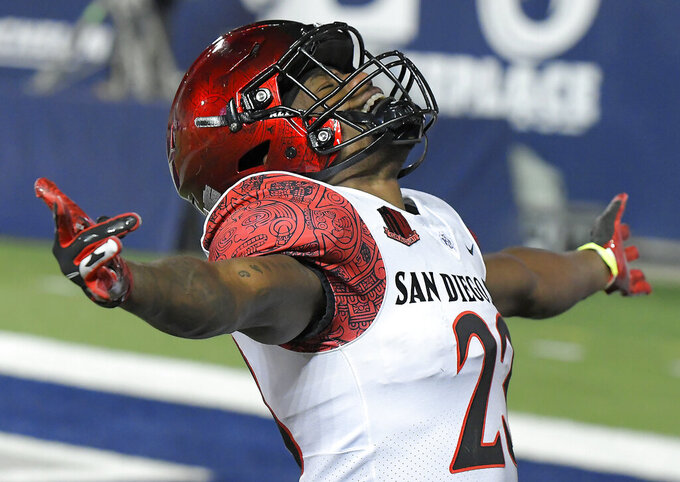 San Diego State cornerback Darren Hall celebrates after the team's 38-7 over Utah State in an NCAA college football game Saturday, Oct. 31, 2020, in Logan, Utah. (Eli Lucero/The Herald Journal via AP, Pool)