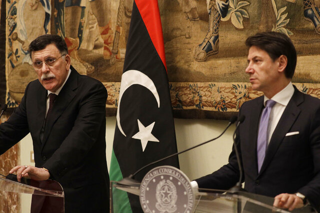 Libya's Prime Minister Fayez al-Sarraj, left, holds a joint press conference with Italian Premier Giuseppe Conte after their meeting at Chigi palace, in Rome, Saturday, Jan. 11, 2020. (AP Photo/Gregorio Borgia)