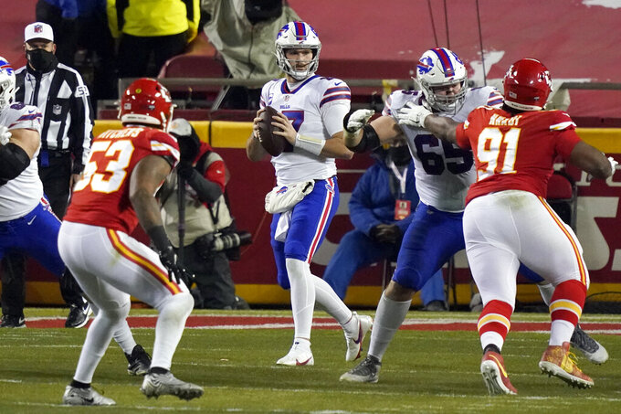 Buffalo Bills quarterback Josh Allen, center, looks to throw a pass during the first half of the AFC championship NFL football game against the Kansas City Chiefs, Sunday, Jan. 24, 2021, in Kansas City, Mo. (AP Photo/Jeff Roberson)