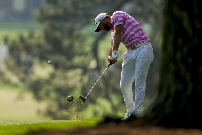 Dustin Johnson hits on the first fairway during the first round of the Masters golf tournament on Thursday, April 8, 2021, in Augusta, Ga. (AP Photo/Matt Slocum)
