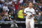 Seattle Mariners' Jarred Kelenic tosses his batting pad after striking out to end the fourth inning of the team's baseball game against the Oakland Athletics, Thursday, July 22, 2021, in Seattle. (AP Photo/Ted S. Warren)