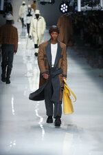 Models wear creations as part of the Fendi men's Fall-Winter 2020/21 collection, that was presented in Milan, Italy, Monday, Jan. 13, 2020. (AP Photo/Antonio Calanni)