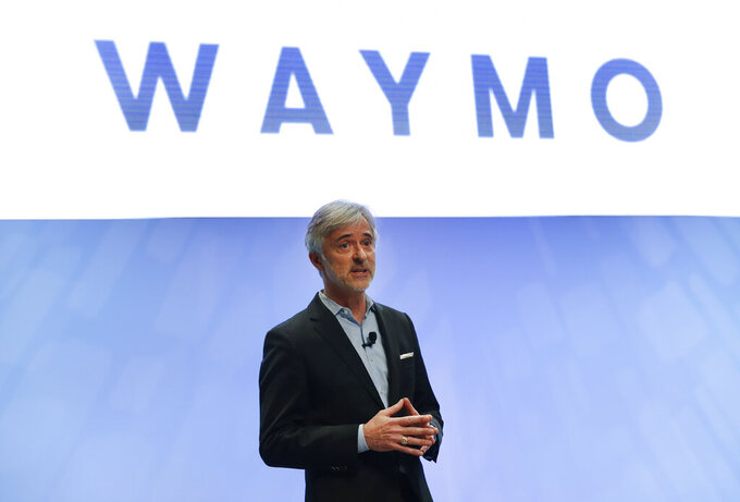 FILE - In this Sunday, Jan. 8, 2017, file photo, John Krafcik, CEO of Waymo, the autonomous vehicle company created by Google's parent company, Alphabet speaks at the North American International Auto Show in Detroit. The executive who steered the transformation of Google's self-driving car project into a separate company worth billions of dollars is stepping down after more than five years on the job. Krafcik announced his departure as CEO of Waymo, a company spun out from Google, in a Friday, April 2, 2021, blog post that cited his desire to enjoy life as the world emerges from the pandemic. (AP Photo/Paul Sancya, File)