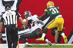 Tampa Bay Buccaneers tight end Rob Gronkowski (87) makes a 12-yard touchdown catch in front of Green Bay Packers strong safety Adrian Amos (31) during the first half of an NFL football game Sunday, Oct. 18, 2020, in Tampa, Fla. (AP Photo/Mark LoMoglio)