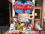 "FILE—In this file photo from Aug. 4, 2019, a makeshift memorial was placed outside Ned Peppers bar following a vigil at the scene of the mass shooting in Dayton, Ohio. Trey Landers, a Dayton native and senior guard on the University of Dayton basketball team was there when a masked gunman in body armor opened fire early that Sunday. He has now helped his basketball team to its best start ever at 26-2 and to No. 4 in the current Associated Press poll, its highest ranking in 64 years. People greet or email him to ""just thank me and my teammates for everything we're doing right now,"" Landers said. ""Our team is helping pull the city together a little bit ... It's bigger than us.""(AP Photo/Dan Sewell, File)"