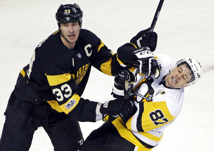 FILE - In this  Thursday, Jan. 26, 2017 file photo, Boston Bruins defenseman Zdeno Chara (33) pushes Pittsburgh Penguins center Sidney Crosby (87) from the crease in the third period of an NHL hockey game in Boston. Longtime Boston Bruins captain Zdeno Chara signed with the Washington Capitals on Wednesday, Dec. 30, 2020, a stunning move less than a week before most NHL teams open training camp.  (AP Photo/Elise Amendola, File)