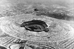 FILE - In this April 10, 1962, file photo, a helicopter hovers over Dodger Stadium on Opening Day of the baseball season as the Los Angeles Dodgers play their first game at the new 56,000-seat stadium in Chavez Ravine against the Cincinnati Reds near Los Angeles, Calif. (AP Photo/File)