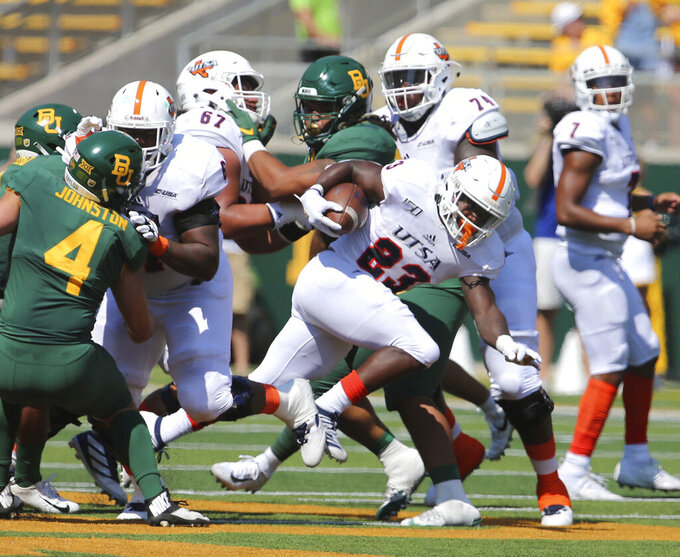 UTSA running back Sincere McCormick (23) breaks loose past the line of scrimmage for a short gain against Baylor in the first half of an NCAA college football game, Saturday, Sept. 7, 2019, in Waco, Texas. (Rod Aydelotte/Waco Tribune-Herald via AP)
