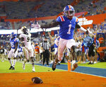 FILE - Florida receiver Kadarius Toney (1) celebrates a touchdown against Missouri during an NCAA college football game in Gainesville, Fla., in this Saturday, Oct. 31, 2020, file photo. No. 6 Florida doesn't really even try to run the ball anymore. There's an occasional handoff here and there, but the Gators are mostly one-dimensional _ and that's fine with coach Dan Mullen, Heisman Trophy front-runner Kyle Trask and arguably the deepest receiving corps in the country.(Brad McClenny/The Gainesville Sun via AP, File)
