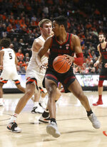 Stanford's KZ Okpala (0) pivots past Oregon State's Tres Tinkle during the first half of an NCAA college basketball game in Corvallis, Ore., Thursday, Feb. 7, 2019. (AP Photo/Amanda Loman)