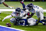 Tennessee Titans free safety Desmond King (33) reaches for a fumble by Indianapolis Colts wide receiver T.Y. Hilton (13) in the second half of an NFL football game in Indianapolis, Sunday, Nov. 29, 2020. Hilton was ruled down on the play. (AP Photo/Darron Cummings)