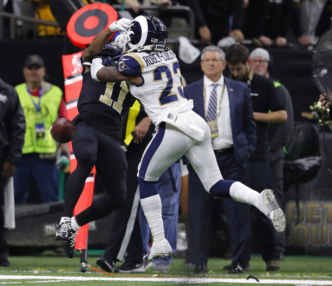 Los Angeles Rams defensive back Nickell Robey-Coleman (23) defends against New Orleans Saints wide receiver Tommylee Lewis (11) during the second half the NFL football NFC championship game Sunday, Jan. 20, 2019, in New Orleans. The Rams won 26-23.(AP Photo/Carolyn Kaster)