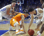 Tennessee's Grant Williams, middle, tries to pull in a loose ball between Kentucky's Reid Travis, left, and Tyler Herro during the second half of an NCAA college basketball game in Lexington, Ky., Saturday, Feb. 16, 2019. Kentucky won 86-69. (AP Photo/James Crisp)