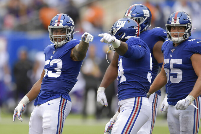 New York Giants linebacker Oshane Ximines (53) reacts after sacking Minnesota Vikings quarterback Kirk Cousins (8) during the second quarter of an NFL football game, Sunday, Oct. 6, 2019, in East Rutherford, N.J. (AP Photo/Bill Kostroun)