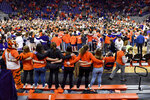 Clemson fans and players celebrate after an NCAA college basketball game against Florida State Saturday, Feb. 29, 2020, in Clemson, S.C. Clemson won 70-69. (AP Photo/Richard Shiro)