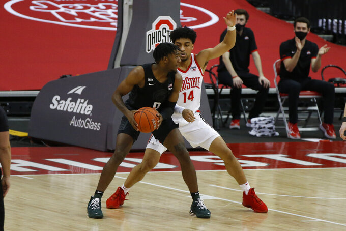 Michigan State's Aaron Henry, left, posts up against Ohio State's Justice Sueing during the first half of an NCAA college basketball game Sunday, Jan. 31, 2021, in Columbus, Ohio. (AP Photo/Jay LaPrete)