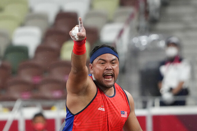 FILE - In this Tuesday, Aug. 31, 2021, file photo, Muhammad Ziyad Zolkefli of Malaysia reacts after competing in the men's shot put F20 final during the Tokyo 2020 Paralympics Games at the National Stadium in Tokyo. Zolkefli appeared to have won gold in the shot put in the F20 class. But after the victory on Tuesday, he was disqualified because he had shown up late for the competition. (AP Photo/Eugene Hoshiko, File)