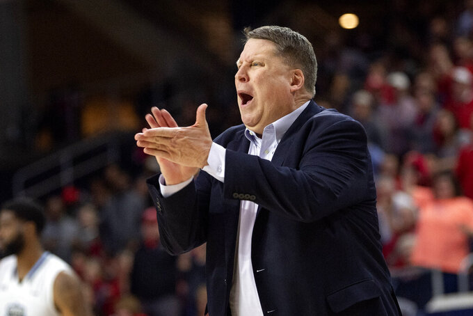 Old Dominion coach Jeff Jones yells to his players during the second half of an NCAA college basketball game against Western Kentucky for the Conference USA men's tournament championship Saturday, March 16, 2019, in Frisco, Texas. Old Dominion won 62-56. (AP Photo/Jeffrey McWhorter)
