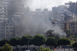 Black smoke rise from burning tires that were set fire to block a road during a protest against government's plans to impose new taxes in Beirut, Lebanon, Saturday, Oct. 19, 2019. The blaze of protests was unleashed a day earlier when the government announced a slate of new proposed taxes, including a $6 monthly fee for using Whatsapp voice calls. The measures set a spark to long-smoldering anger against top leaders from the president and prime minister to the numerous factional figures many blame for decades of corruption and mismanagement. (AP Photo/Hassan Ammar)