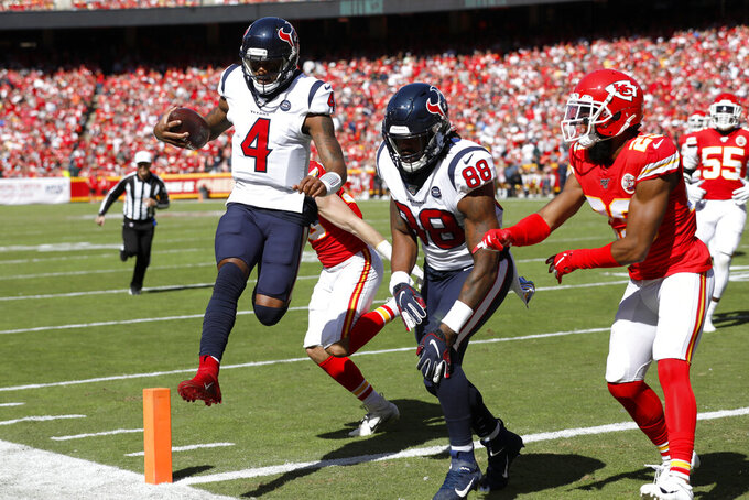 Houston Texans quarterback Deshaun Watson (4) scores a touchdown next to tight end Jordan Akins (88) during the first half of an NFL football game against the Kansas City Chiefs in Kansas City, Mo., Sunday, Oct. 13, 2019. (AP Photo/Colin E. Braley)