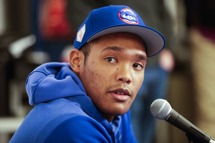 Chicago Cubs shortstop Addison Russell speaks at a press conference after a spring training baseball workout Friday, Feb. 15, 2019, in Mesa, Ariz. (AP Photo/Morry Gash)