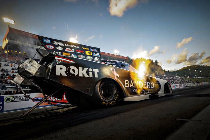 In this photo provided by the NHRA, Alexis DeJoria drives in Funny Car qualifying Saturday, Oct. 16, 2021, at the NHRA Thunder Valley Nationals drag races at Bristol Dragway in Bristol, Tenn. (NHRA via AP)