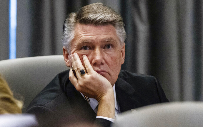 Mark Harris, Republican candidate in North Carolina's 9th congressional race, listens to testimony during a public evidentiary hearing on the 9th congressional district voting irregularities investigation Tuesday, Feb. 19, 2019, at the North Carolina State Bar in Raleigh, N.C. (Travis Long/The News & Observer via AP, Pool)