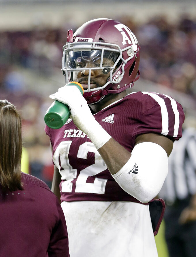 Texas A&M linebacker Otaro Alaka (42) drinks before an NCAA college football game against UAB Saturday, Nov. 17, 2018, in College Station, Texas. (AP Photo/Michael Wyke)