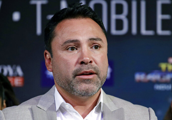 FILE - In this Sept. 13, 2017 file photo, Oscar de la Hoya speaks during a news conference in Las Vegas. De La Hoya denies accusations of sexual assault contained in a lawsuit filed against him this week. The boxing promoter's company, Golden Boy Promotions, issued a statement Tuesday, Oct. 22, 2019, describing the action as a