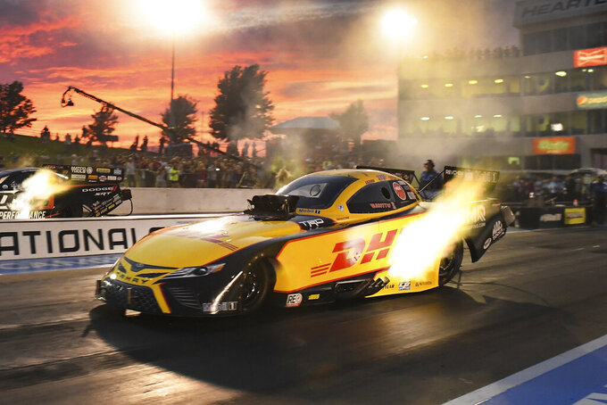 In this photo provided by the NHRA, J.R. Todd drives in Funny Car qualifying Friday, Aug. 13, 2021, at the Menards NHRA Nationals drag races at Heartland Motorsports Park in Topeka, Kan. (Marc Gewertz/NHRA via AP)