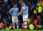 Manchester City's David Silva, left, speaks with Manchester City's Kevin De Bruyne during the English Premier League soccer match between Manchester City and Manchester United at Etihad stadium in Manchester, England, Saturday, Dec. 7, 2019. (AP Photo/Rui Vieira)
