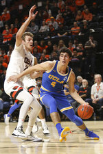 UCLA's Jaime Jaquez Jr. (4) darts around Oregon State's Kylor Kelley (24) during the first half of an NCAA college basketball game in Corvallis, Ore., Thursday, Jan. 23, 2020. (AP Photo/Amanda Loman)