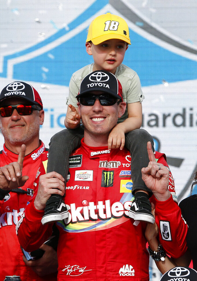 Kyle Busch and his son Brexton in victory lane after winning the NASCAR Cup Series auto race at ISM Raceway, Sunday, March 10, 2019, in Avondale, Ariz. (AP Photo/Ralph Freso)