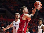 Wisconsin forward Ethan Happ (22) shoots past Illinois forward Giorgi Bezhanishvili (15) during the second half of an NCAA college basketball game in Champaign, Ill., Wednesday, Jan. 23, 2019. (AP Photo/Stephen Haas)