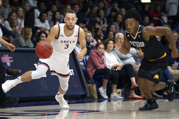 Saint Mary's guard Jordan Ford (3) drives past Winthrop guard Russell Jones (0) during the first half of an NCAA men's college basketball game, Monday, Nov. 11, 2019 in Moraga, Calif. (AP Photo/D. Ross Cameron)