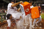 Boston Red Sox dump water onto Hunter Renfroe after their 2-1 win over the Tampa Bay Rays in a baseball game Wednesday, Sept. 8, 2021, at Fenway Park in Boston. Renfroe hit a two-run home run in the eighth and threw out a runner at third to end the game. (AP Photo/Winslow Townson)