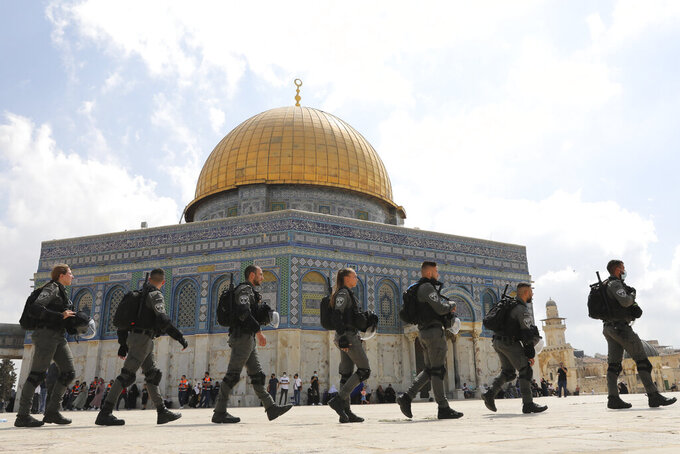 Israeli police maneuver through the Al Aqsa Mosque compound after Friday prayers to clear a protest a protest celebrating the six Palestinian prisoners who tunneled out of Gilboa Prison, in the Old City of Jerusalem, Friday, Sept. 10, 2021. (AP Photo/Mahmoud Illean)