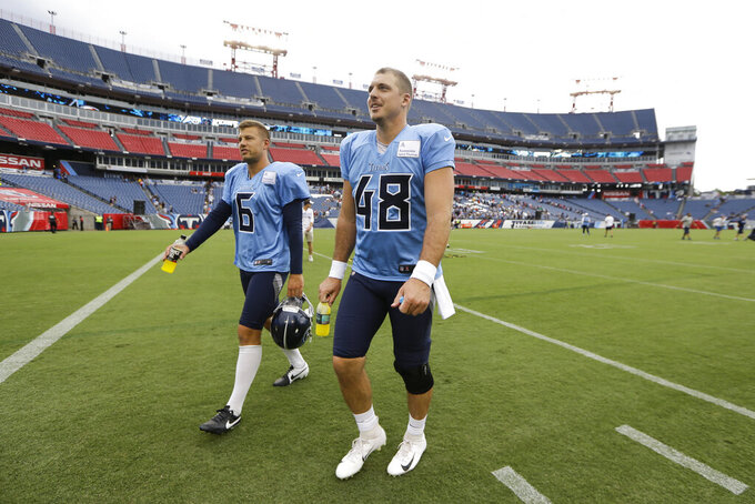 Concert, fireworks lure fans to wet Titans' practice