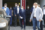 Italian former Premier Silvio Berlusconi leaves the San Raffaele hospital in Milan, Italy, Monday, Sept. 14, 2020. Berlusconi had been hospitalized as a precaution to monitor his coronavirus infection after testing positive for COVID-19. (AP Photo/Luca Bruno)