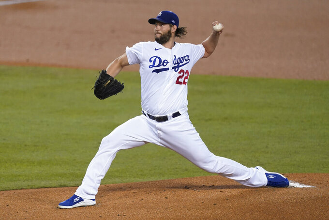 Los Angeles Dodgers starting pitcher Clayton Kershaw throws during the first inning of the team's baseball game against the Los Angeles Angels on Friday, Sept. 25, 2020, in Los Angeles. (AP Photo/Ashley Landis)