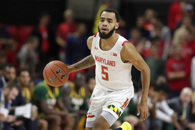 Maryland guard Eric Ayala brings the ball up during the second half of the team's NCAA college basketball game against George Mason on Friday, Nov. 22, 2019, in College Park, Md. Maryland won 86-63. (AP Photo/Julio Cortez)